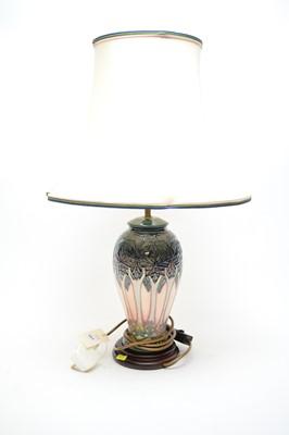 Lot 301 - A Moorcroft table lamp.