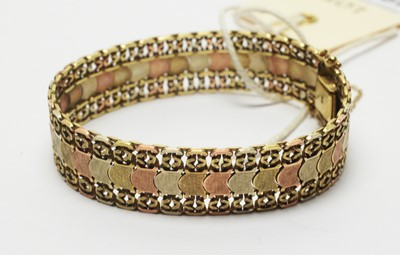 Lot 198 - A yellow, rose and white gold bracelet.