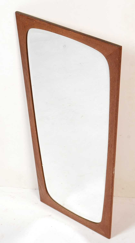 Lot 763 - A Danish teak framed mirror.