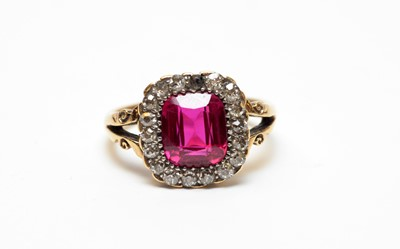 Lot 27 - A yellow metal, diamond, and synthetic ruby ring.