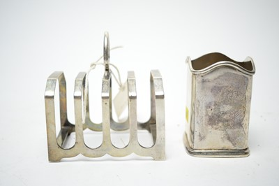 Lot 175 - Silver bottle stand and toast rack
