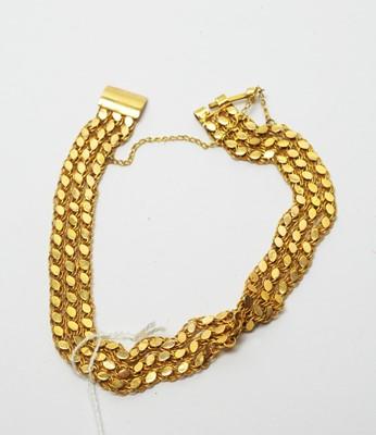 Lot 206 - A yellow metal bracelet.