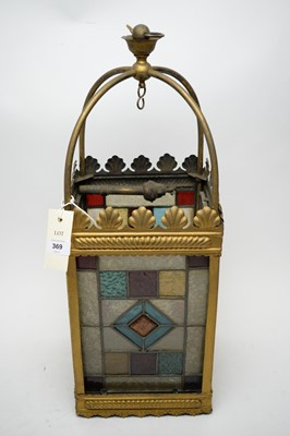 Lot 369 - A brass lantern with stained and opaque glass panels