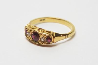 Lot 192 - A garnet and diamond ring.