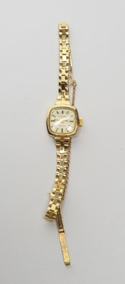 Lot 194 - A gold cocktail watch by Excaliber.