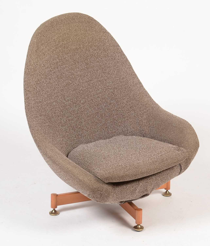 Lot 796 - A moulded foam swivel chair