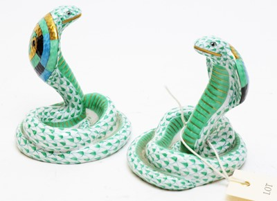 Lot 343 - A Pair of Herend cobra figures.