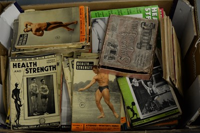 Lot 476 - A collection of 20th century health and fitness magazines and a set of Sandows dumb bells.