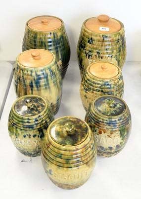 Lot 409 - A set of seven tortoise glazed jars