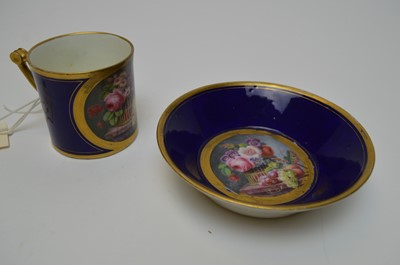 Lot 416 - A Sevra hand-painted cup and saucer