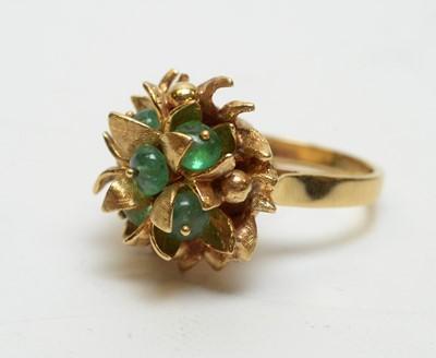 Lot 222 - An emerald set yellow metal basket pattern ring