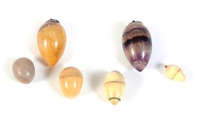 Lot 217 - Six egg-shaped pendants, various.