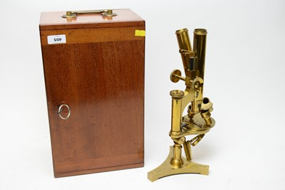 Lot 405 - A cased brass microscope by R&J Beck