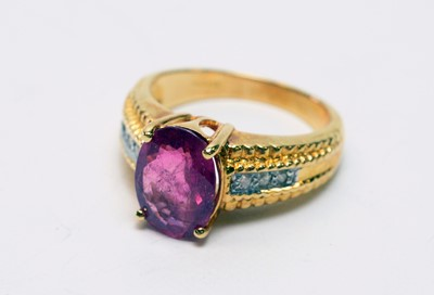 Lot 155 - Ruby and diamond ring