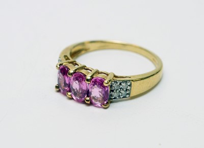 Lot 162 - Pink sapphire and diamond ring