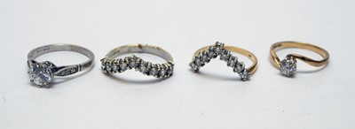 Lot 171 - Four CZ or white stone rings