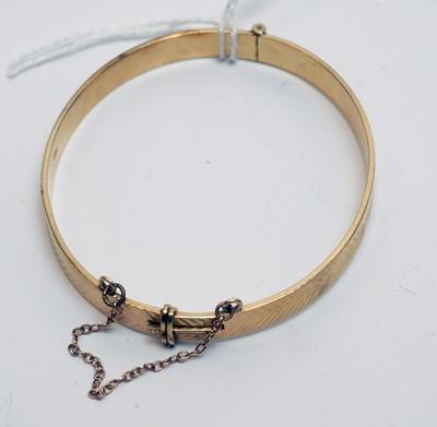 Lot 178 - A 9ct yellow gold bangle