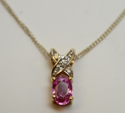Lot 198 - A pink sapphire and dimond pendant