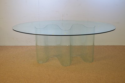 Lot 52 - 20th C glass oval glass dining table.