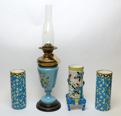 Lot 493 - A brass oil lamp and three vases.