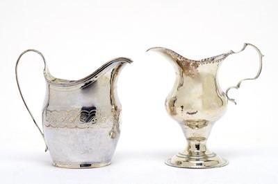 Lot 148 - Two Georgian silver milk jugs