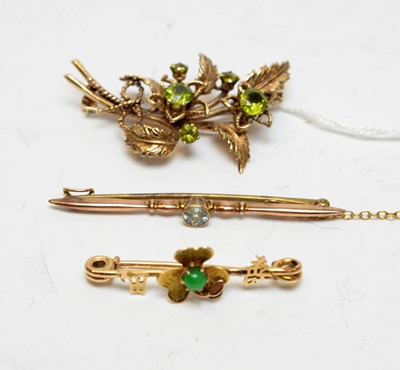 Lot 108 - Three gold and yellow-metal gem-set brooches.