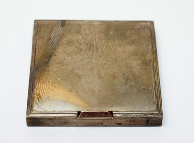 Lot 33 - A lady's white-metal powder compact of Art Deco influence.