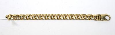 Lot 30 - A 9ct gold double curb-link bracelet.