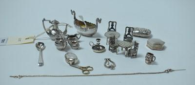 Lot 181 - A collection of silver miniature novelties, including a four piece tea service.