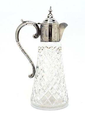 Lot 199 - A silver mounted cut glass claret jug