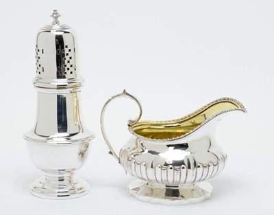 Lot 176 - A George IV silver jug and George V silver caster
