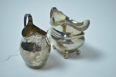 Lot 155 - Two Georgian silver jugs.