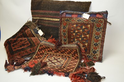 Lot 286 - A selection of Middle Eastern saddlebags and similar pillows