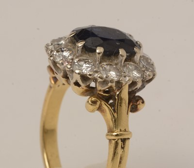 Lot 113 - A sapphire and diamond cluster ring