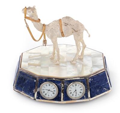 Lot 464 - A camel mounted lapis lazuli desktop clock
