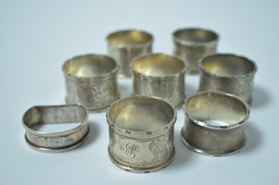 Lot 132 - A set of six silver napkin rings and two further.
