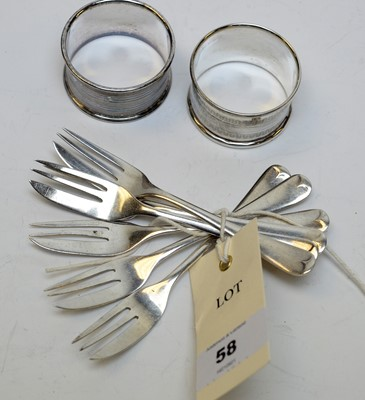 Lot 58 - A set of six George V silver cake forks and two napkin rings.