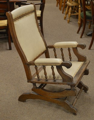 Lot 10A - An American-style oak rocking chair, late 19th/early 20th Century