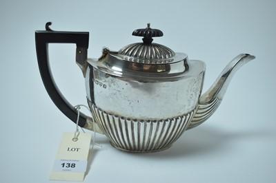 Lot 138 - A George V silver tea pot.