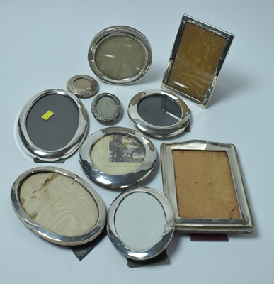 Lot 175 - A large group of ten silver photograph frames