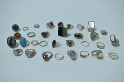 Lot 195 - A large collection of contemporary white metal and semi-precious gemstone rings