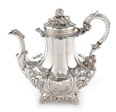 Lot 183 - A George III Irish silver coffee pot.