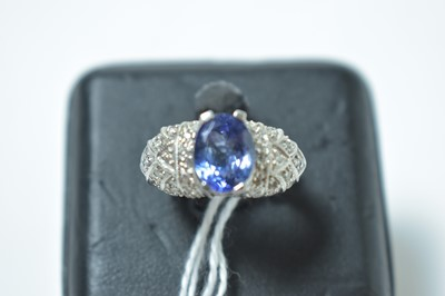 Lot 228 - A contemporary white metal, tanzanite and diamond cocktail ring
