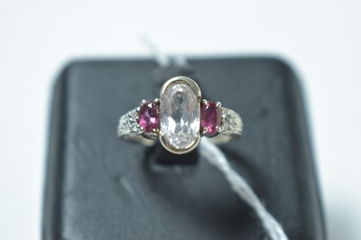 Lot 223 - A contemporary 14ct white gold, white sapphire, ruby and diamond ring