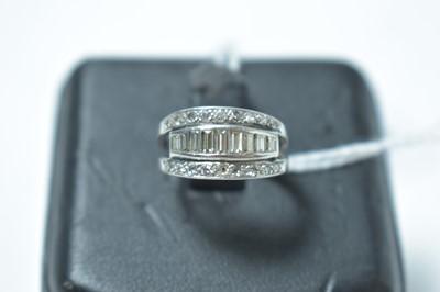 Lot 222 - A vintage platinum and diamond half hoop eternity ring.