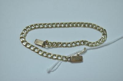 Lot 214 - A yellow metal curb link bracelet