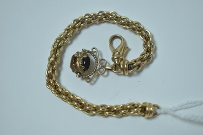 Lot 219 - A yellow metal rope-link watch chain with swivel fob seal
