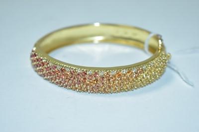 Lot 203 - A gem set yellow metal bangle