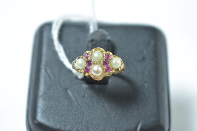 Lot 231 - A late Victorian ruby and half pearl ring