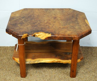Lot 28 - A 20th Century yew wood coffee table.